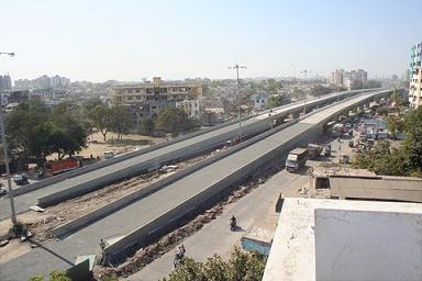 Construction of 2 two lane bridge on Surat Bardoli Road at Aai Mata junction, Surat.