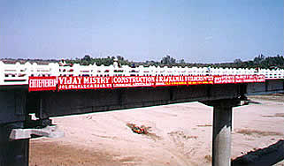 Design & Construction of two lane bridge across river Mahi its approaches near Vasad from km 91/5 to 93/0 and its merging in A'bad-Baroda sections of NH No. 8 (Under BOT Scheme)