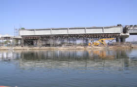 Construction of four lane bridge across river Sabarmati connecting Vasna Pirana on 120 feet road at Ahmedabad.