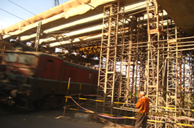 Casting of ROB Portion superstructure over electrified track in a running train condition