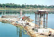 Construction of 240 MLD Capacity Raw Water Intake Systems (including approach Bridge) at Sarthana Water Works.