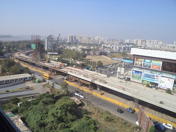 Construction of flyover on Surat Hazira main road near Star Bazar Junction, Surat.